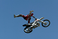 """Jul 01, 2003; Anaheim, California, USA; Moto X star athlete CHUCK CAROTHERS executing a tremendous splits feet free with a full sized motobike at the opening of Disney's California Adventure """"X Games Experience"""".  Disney park has built two X-Arena's specifically for this 41 day event highlighting extreme sports for the launch of the 2003 ESPN X Games.<br />Mandatory Credit: Photo by Shelly Castellano/Icon SMI<br />(©) Copyright 2003 by Shelly Castellano"""