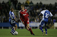 Photo: Lee Earle.<br /> Reading v Liverpool. Carling Cup. 25/09/2007. Liverpool's Peter Crouch (C) sprints past Reading's James Harper (L) and merse FAe.