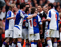 Photo: Glyn Thomas.<br />Liverpool v Blackburn Rovers. The Barclays Premiership.<br />15/10/2005.<br />Blackburn players surround referee Mark Halsey (third from R) after his decision to show the red card to Zurab Khizanishvili.