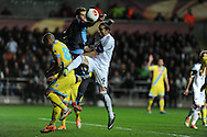 Swansea city's Chico Flores looks to get on the end of a ball but is denied by Napoli keeper Rafael Cabral. UEFA Europa league match , Swansea city v Napoli at the Liberty Stadium in Swansea, South Wales on Thursday 20th Feb 2014. pic by Andrew Orchard, Andrew Orchard sports photography.