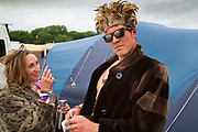 Glastonbury Festival, 2015.<br /> Happy couple returning to their tent at dawn having just seen the Dali Lama