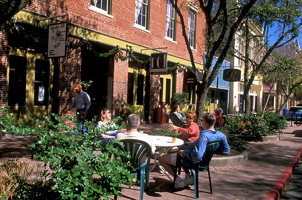 Group eating at an outdoor restaurant table in Galveston, Texas