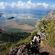 A woman climbing along the path on the Summit hike of Le Morne, a UNESCO World Heritage Site