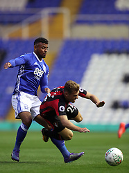 Birmingham City's Isaac Vassell (left) and AFC Bournemouth's Ryan Fraser battle for the ball during the Carabao Cup, Second Round match at St Andrew's, Birmingham.