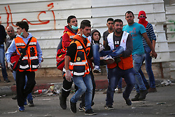 08.10.2015, Ramallah, PSE, Gewalt zwischen Palästinensern und Israelis, im Bild Zusammenstösse zwischen Palästinensischen Demonstranten und Israelischen Sicherheitskräfte // Palestinian medics carry a wounded Palestinian protester during clashes with Israeli security forces in Beit El, near the West Bank city of Ramallah. New violence rocked Israel and the Israeli occupied West Bank, including an incident in which men thought to be undercover Israeli police opened fire on Palestinian stone throwers they had infiltrated, wounding three of them, Palestine on 2015/10/08. EXPA Pictures © 2015, PhotoCredit: EXPA/ APAimages/ Shadi Hatem<br /> <br /> *****ATTENTION - for AUT, GER, SUI, ITA, POL, CRO, SRB only*****