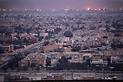 Downtown Kuwait city with burning oil wells in the distance after the end of the Gulf War in 1991. More than 700 wells were set ablaze by retreating Iraqi troops creating the largest man-made environmental disaster in history.