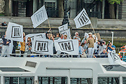 Bob Geldof (pictured right in hat) harangs Farage froman In Campaign river cruiser - .Nigel Farage, the leader of Ukip, joins a flotilla of fishing trawlers up the Thames to Parliament to call for the UK's withdrawal from the EU, in a protest timed to coincide with prime minister's questions.