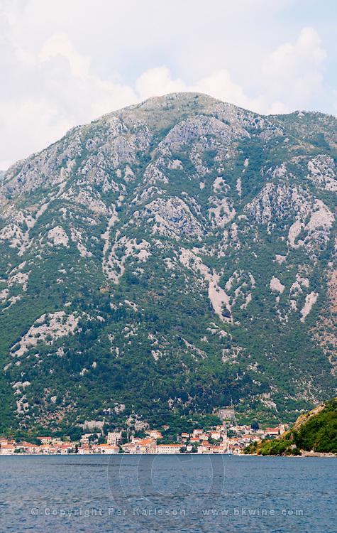 The narrow straight between Kamenari and Lepetani, view towards Perast and an impressive mountain top falling down to the sea bay Kotorski Montenegro, Balkan, Europe.