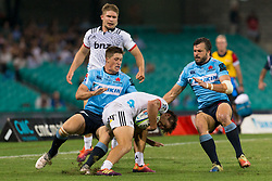 March 23, 2019 - Sydney, NSW, U.S. - SYDNEY, NSW - MARCH 23: Crusaders player Jack Goodhue (13) is tackled by at round 6 of Super Rugby between NSW Waratahs and Crusaders on March 23, 2019 at The Sydney Cricket Ground, NSW. (Photo by Speed Media/Icon Sportswire) (Credit Image: © Speed Media/Icon SMI via ZUMA Press)