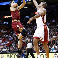 24 January 2012: Cleveland Cavaliers small forward Omri Cassi (36) takes a jumpshot over Miami Heat small forward Shane Battier (31) during the Miami Heat 92-85 victory over the Cleveland Cavaliers at the AmericanAirlines Arena, Miami, Florida, USA.