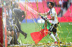 Fulham's Rui Fonte sprays a bottle of champagne to celebrate winning promotion at the end of the Sky Bet Championship Final at Wembley Stadium