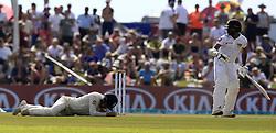 November 7, 2018 - Galle, Sri Lanka - Sri Lankan cricketer Niroshan Dickwella looks on as England cricketer Rory Burns (L) lies down after being hit during the 2nd day's play of the first test cricket match between Sri Lanka and England at Galle International cricket stadium, Galle, Sri Lanka. 11-07-2018  (Credit Image: © Tharaka Basnayaka/NurPhoto via ZUMA Press)