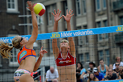 06-06-2010 VOLLEYBAL: JIBA GRAND SLAM BEACHVOLLEYBAL: AMSTERDAM<br /> In een koninklijke ambiance streden de nationale top, zowel de dames als de heren, om de eerste Grand Slam titel van het seizoen bij de Jiba Eredivisie Beach Volleyball - Laura Bloem en Ilke Meertens<br /> ©2010-WWW.FOTOHOOGENDOORN.NL