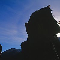 ROCK CLIMBING. Gallatin Canyon, Montana,  Rock climbers on spire.