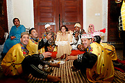 On Monday evening, May 28, 2007, a group of Gnaoua musicians take a break between preformances at a private Riad in Fes, Morocco. The Gnaoua people make trance-like music that expresses their intense energy and history of slavery. (PHOTO BY TIMOTHY D. BURDICK)
