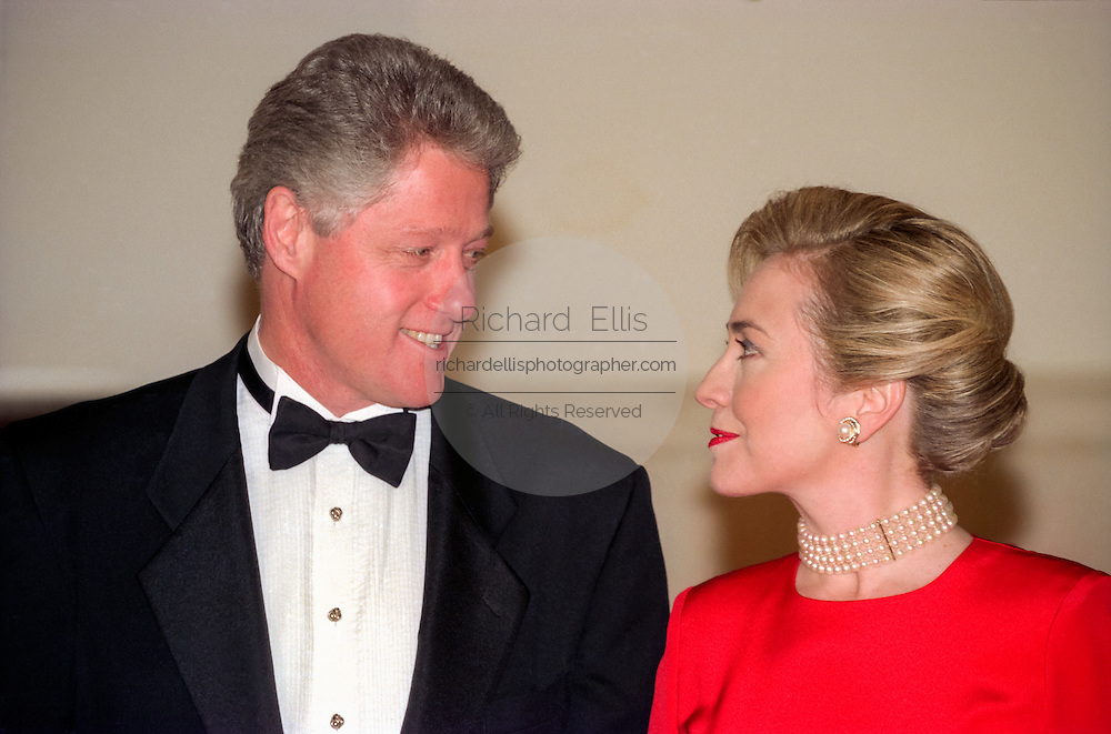 U.S President Bill Clinton and First Lady Hillary Rodham Clinton in formal wear wait for the arrival of Colombian President Andres Pastrana and his wife, First Lady Nohra for a State Dinner at the White House October 28, 1998 in Washington DC.