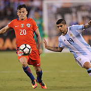 EAST RUTHERFORD, NEW JERSEY - JUNE 26:  Charles Aranguiz #20 of Chile is challenged by Ever Banega #19 of Argentina during the Argentina Vs Chile Final match of the Copa America Centenario USA 2016 Tournament at MetLife Stadium on June 26, 2016 in East Rutherford, New Jersey. (Photo by Tim Clayton/Corbis via Getty Images)