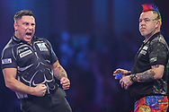 Gerwyn Price hits a double and wins a leg against Peter Wright during the PDC William Hill World Darts Championship Semi-Final at Alexandra Palace, London, United Kingdom on 30 December 2019.