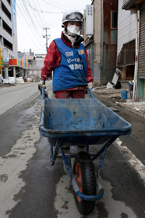 Ryoko Kido a media worker and a Peace Boat volunteer takes part in the clean-up operations in Ishinomaki, Miyagi Friday May 6th 2011. Around 350 volunteers took part in the relief effort over the Golden Week holiday, including 41 foreigners, clearing mud and removing debris from this coastal town which more almost levelled in the March 11th earthquake and tsunami.
