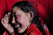 Haircuts of a Kyrgyz woman...Trekking with yak caravan through the Little Pamir where the Afghan Kyrgyz community live all year, on the borders of China, Tajikistan and Pakistan.