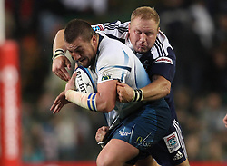 CAPE TOWN, SOUTH AFRICA - 11 JUNE 2011, Bulls prop Dean Greyling attempts to break Stormers prop Brok Harris tackle during the Super Rugby match between DHL Stormers and the Bulls held at DHL Newlands Stadium in Cape Town, South Africa..Photo by Shaun Roy / Sportzpics.net