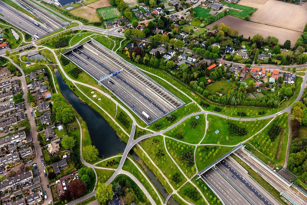 Nederland, Noord-Brabant, Breda, 09-05-2013; infrabundel, combinatie van autosnelweg A16 gebundeld met de spoorlijn van de HSL (re). Stadsduct Overbos in de voorgrond, Stadsduct Valbos in de achtergond.<br /> De bundel loopt in tunnelbakken, lokale wegen gaan over deze infrabundel heen, door middel van de zogenaamde stadsducten, gedeeltelijk ingericht als stadspark. <br /> Combination of motorway A16 and the HST railroad, crossed by  local roads by means of *urban ducts*, partly designed as public  parks .<br /> luchtfoto (toeslag op standard tarieven);<br /> aerial photo (additional fee required);<br /> copyright foto/photo Siebe Swart.