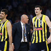 Fenerbahce Ulker's coach Neven SPAHIJA (C) and Darjus LAVRINOVIC (R), Omer ONAN (L) during their Turkish Basketball league Play Off Final third leg match Galatasaray between Fenerbahce Ulker at the Abdi Ipekci Arena in Istanbul Turkey on Thursday 09 June 2011. Photo by TURKPIX