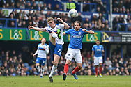 Rochdale Midfielder, Ethan Hamilton (27) beats Portsmouth Forward, Brett Pitman (8) to the ball during the EFL Sky Bet League 1 match between Portsmouth and Rochdale at Fratton Park, Portsmouth, England on 13 April 2019.