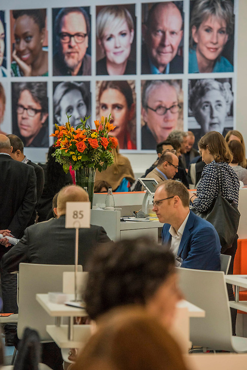 The Penguin stand in front of the Harper Collins stand - The London Book Fair, celebrating its 45 year anniversary, is the global marketplace for rights negotiation and the sale and distribution of content across print, audio, TV, film and digital channels. Staged annually, LBF sees more than 25,000 publishing professionals arrive in London for the week of the show to learn, network and kick off their year of business. The London Book Fair sits at the heart of London Book & Screen Week, and runs from the 12-14 April 2016.