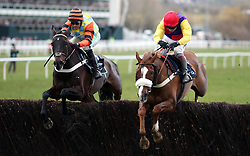 Native River ridden by Richard Johnson (right) jumps a fence before going on to win the Timico Cheltenham Gold Cup Chase ahead of Might Bite ridden by Nico de Boinville during Gold Cup Day of the 2018 Cheltenham Festival at Cheltenham Racecourse.
