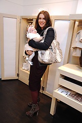 LARA BOHINC and her daughter COCO at a party to celebrate the opening of Pincess Marie-Chantal of Greece's store 'Marie-Chantal' 133A Sloane Street, London on 14th October 2008.