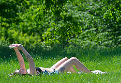 © Licensed to London News Pictures 01/06/2021. Greenwich, UK. A woman sunbathing in the park. People out and about in Greenwich Park, London as the hot heat wave weather continues. Photo credit:Grant Falvey/LNP