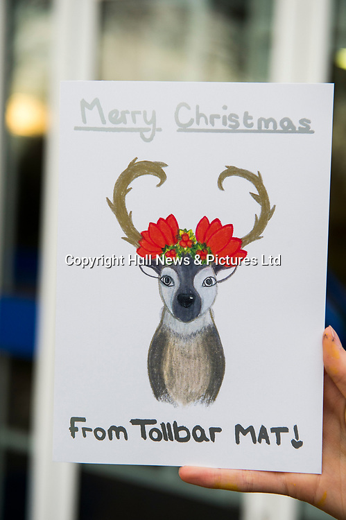 14 December 2018: Somercotes Academy.<br /> Isobel Russell (Year 9) who designed the winning Tollbar MAT<br /> Christmas Card.<br /> Picture: Sean Spencer/Hull News & Pictures Ltd<br /> 01482 210267/07976 433960<br /> www.hullnews.co.uk         sean@hullnews.co.uk