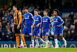 Chelsea p;ayers walk bak after Eden Hazard of Chelsea scores a goal to make it 1-0 - Photo mandatory by-line: Rogan Thomson/JMP - 07966 386802 - 13/12/2014 - SPORT - FOOTBALL - London, England - Stamford Bridge - Chelsea v Hull City - Barclays Premier League.