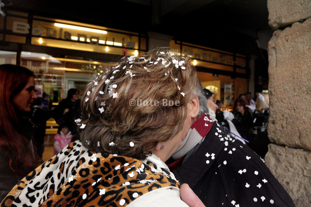 senior couple kissing with confetti over them