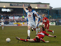 Photo: Leigh Quinnell.<br /> Nuneaton Borough v Middlesbrough. The FA Cup.<br /> 07/01/2006. Middlesbroughs Emanuel Pogatetz challenges Nuneatons Mark Noon.
