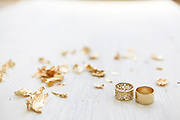 Golden wedding rings on white wooden background