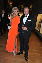 MICK NORCROSS and HANNAH ELIZABETH at the annual Chain of Hope's annual Gala Ball held at the Natural History Museum, London on 8th November 2012.