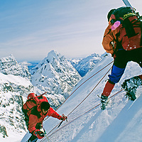 Cordillera Sarmiento, Patagonia, Chile. Phillip Lloyd belays Tyler Van Arsdell up steep, rime-coated face during first ascent of the Fickle Finger of Fate in this previously unexplored range.