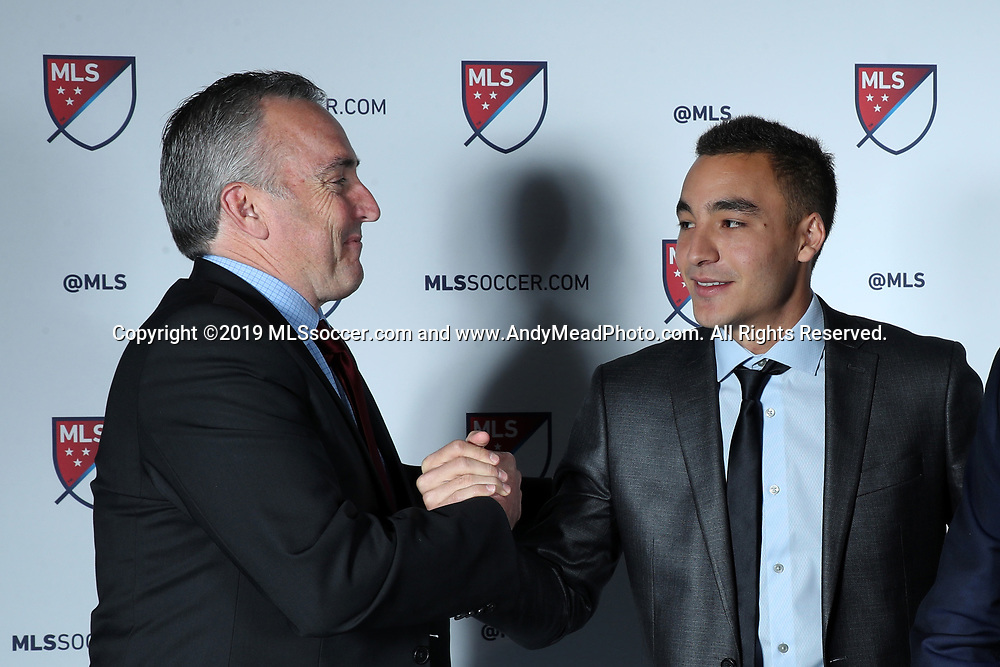 CHICAGO, IL - JANUARY 11: Andre Shinyashiki was taken with the fifth overall pick by the Colorado Rapids. With senior director of soccer development Brian Crookham. The MLS SuperDraft 2019 presented by adidas was held on January 11, 2019 at McCormick Place in Chicago, IL.
