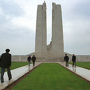 Canadian war veterans walk towards the memorial...Photo taken 10 May 2000 at the Canadian War Memorial at Vimy, France..Credit: Justin Jin