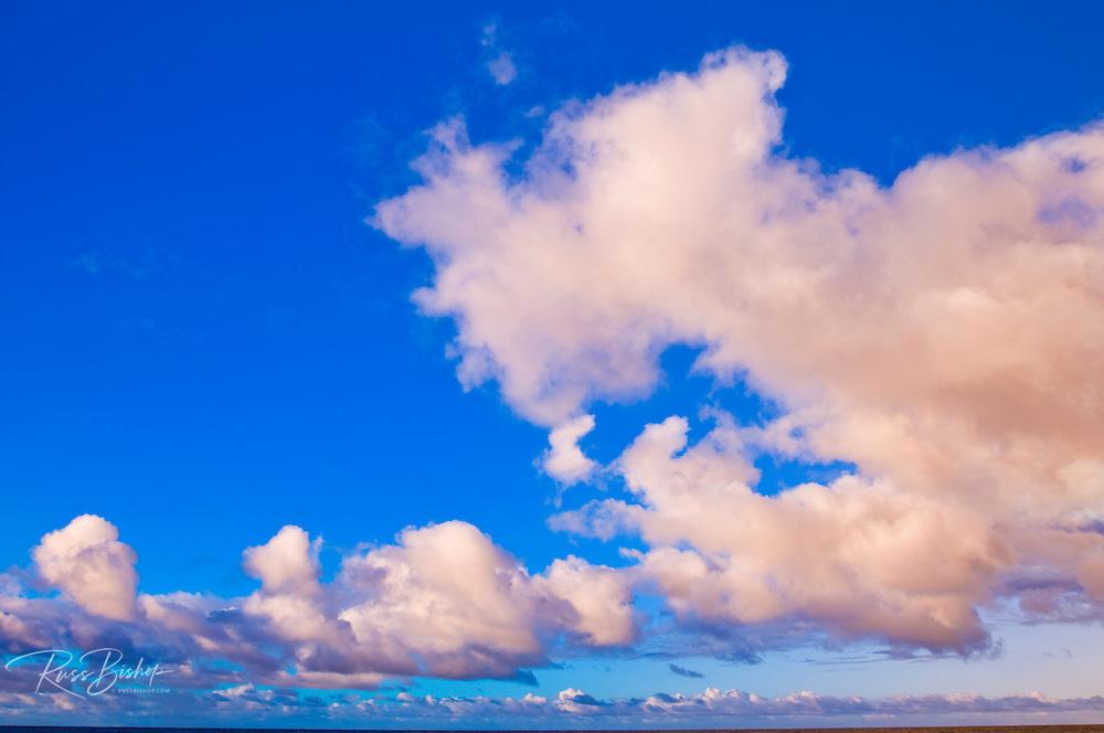 Evening light on clouds over the Pacific Ocean, Island of Kauai, Hawaii