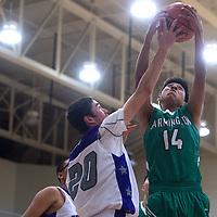 Farmington Scorpion Zack Lee (14) grabs a rebound before Miyamura Patriot Brandon Vidal (20) Friday at Miyamura High School.