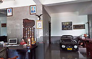 Laos, Champasak Province. Pakse. Vintage Toyota sports cars at the lobby of Pakse Mekong Hotel.