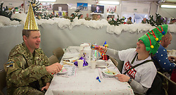 25/12/2013.  Troops in Afghanistan enjoy their Christmas lunch today at Camp Bastion.  This  will be the last time the UK Armed Forces will be deployed over Christmas on operations in the country before the end of Op Herrick in 2014.  Photo credit: Alison Baskerville/LNP