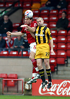 Photo: Dave Linney.<br />Walsall v Port Vale. Coca Cola League 1. 15/04/2006.<br />Walsall's (L) battles for the ball with Mark McGregor