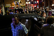 A man exits a limousine as anti-GOP demonstrators participate in a dance party flash mob through the streets of Ybor City during the 2012 Republican National Convention in Tampa, Fla.