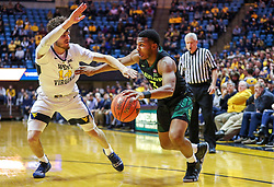Jan 21, 2019; Morgantown, WV, USA; Baylor Bears guard King McClure (3) drives baseline while guarded by West Virginia Mountaineers guard Chase Harler (14) during the first half at WVU Coliseum. Mandatory Credit: Ben Queen-USA TODAY Sports