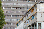 "An urban landscape on the soon-to-be demolished Aylesbury Estate, on 4th September 2018, in Southwark, London, England. The Aylesbury Estate contained 2,704 dwellings in approximately 7500 residents and built between 1963 and 1977 and for decades it was seen as a symbol of the failure of British social housing. There were major problems with the physical buildings on the estate and the poor perception of estates in Britain as a whole have led to the Aylesbury Estate gaining the title of ""one of the most notorious estates in the United Kingdom. Demolition is in progress for the regeneration of the Aylesbury Estate to consist of 3,500 new homes, 50% of which, according to Southwark council, will be affordable."