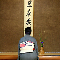 Asia, Japan, Kyoto. Paying respect at home shrine.